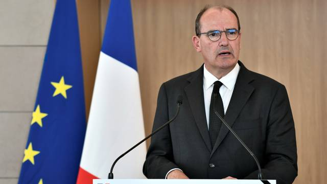 French PM Castex attends a ceremony in tribute to six humanitarian aid workers, in Orly