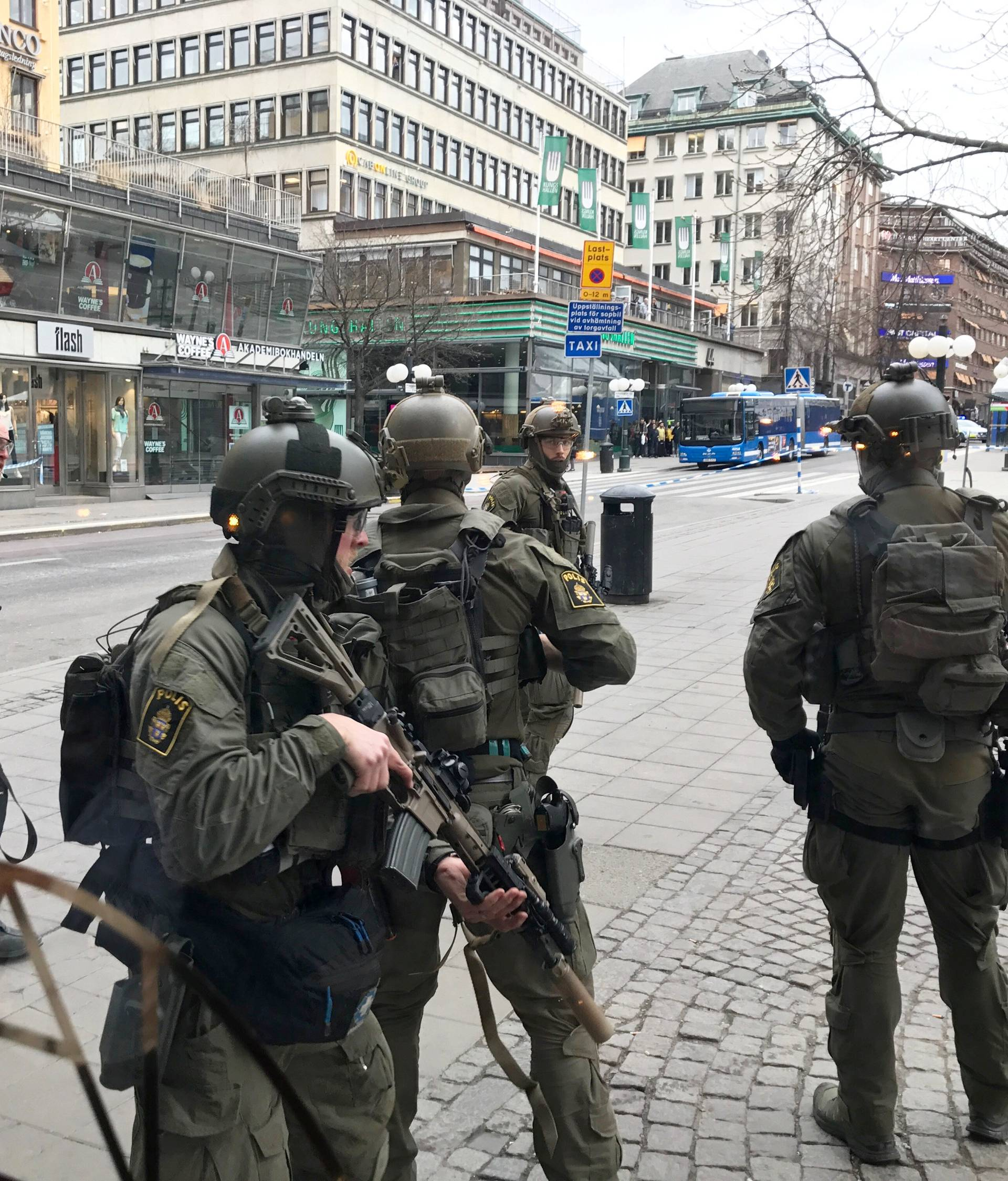 Sweden's police officers guard in the central Stockholm