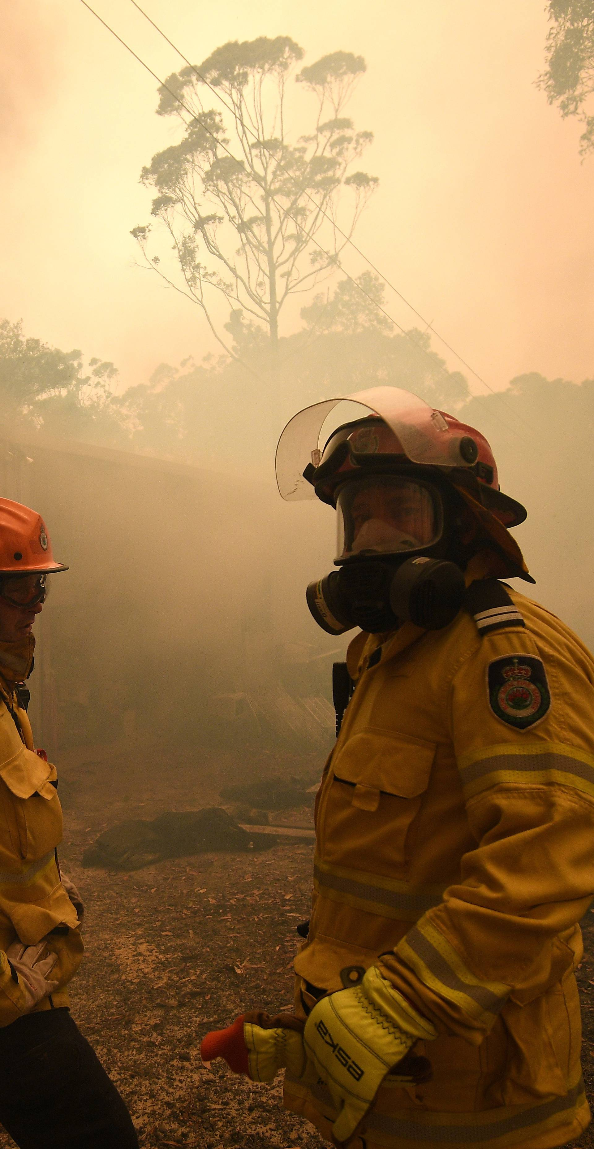 NSW Rural Fire Service and Fire and Rescue NSW crews work to protect a property on Kyola Road in Kulnura