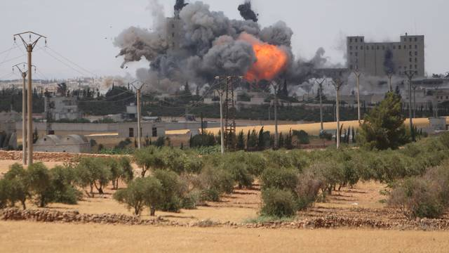 Smoke and flame rise after what fighters of the Syria Democratic Forces (SDF) said were U.S.-led air strikes on the mills of Manbij where Islamic State militants are positioned,  in Aleppo Governorate