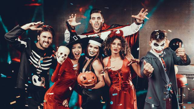 Portrait of Young Smiling People in Scary Costumes