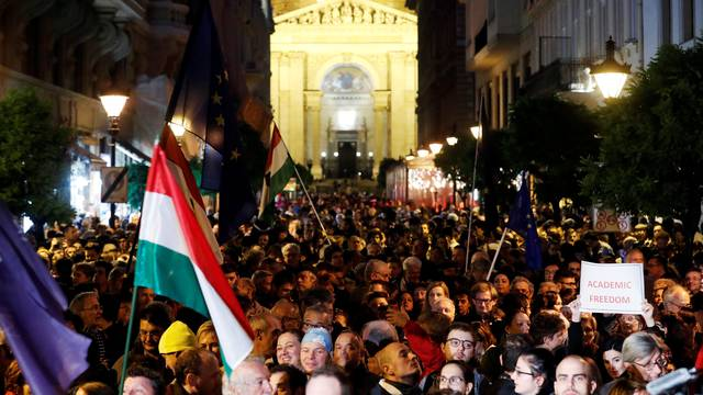People attend a rally outside George Soros's Central European University to protest against the university being forced out of Budapest by Prime Minister Viktor Orban's government in Budapest