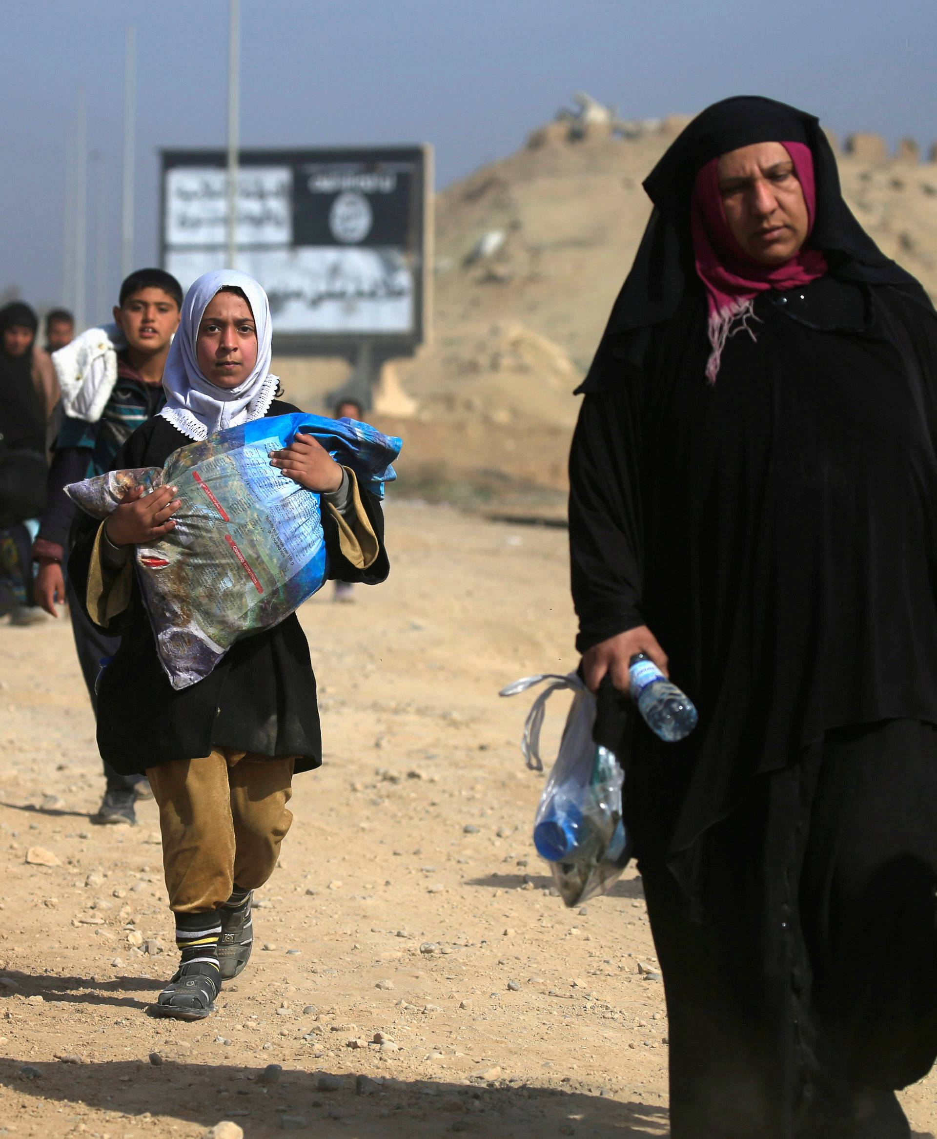 Displaced Iraqi people flee their homes, during the battle against Islamic State militants, at the district of al-Mamoun in Mosul