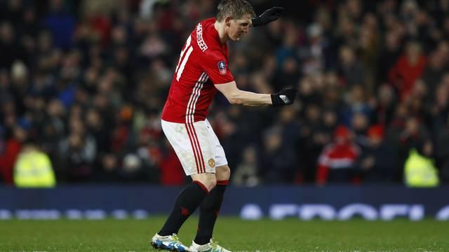 Manchester United's Bastian Schweinsteiger celebrates scoring their fourth goal