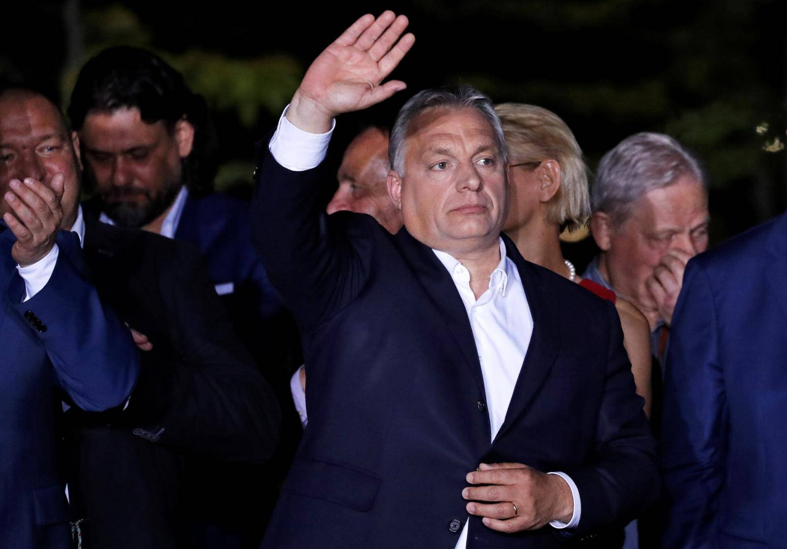 Hungarian Prime Minister Viktor Orban addresses supporters after the preliminary results of the European Parliament election in Budapest