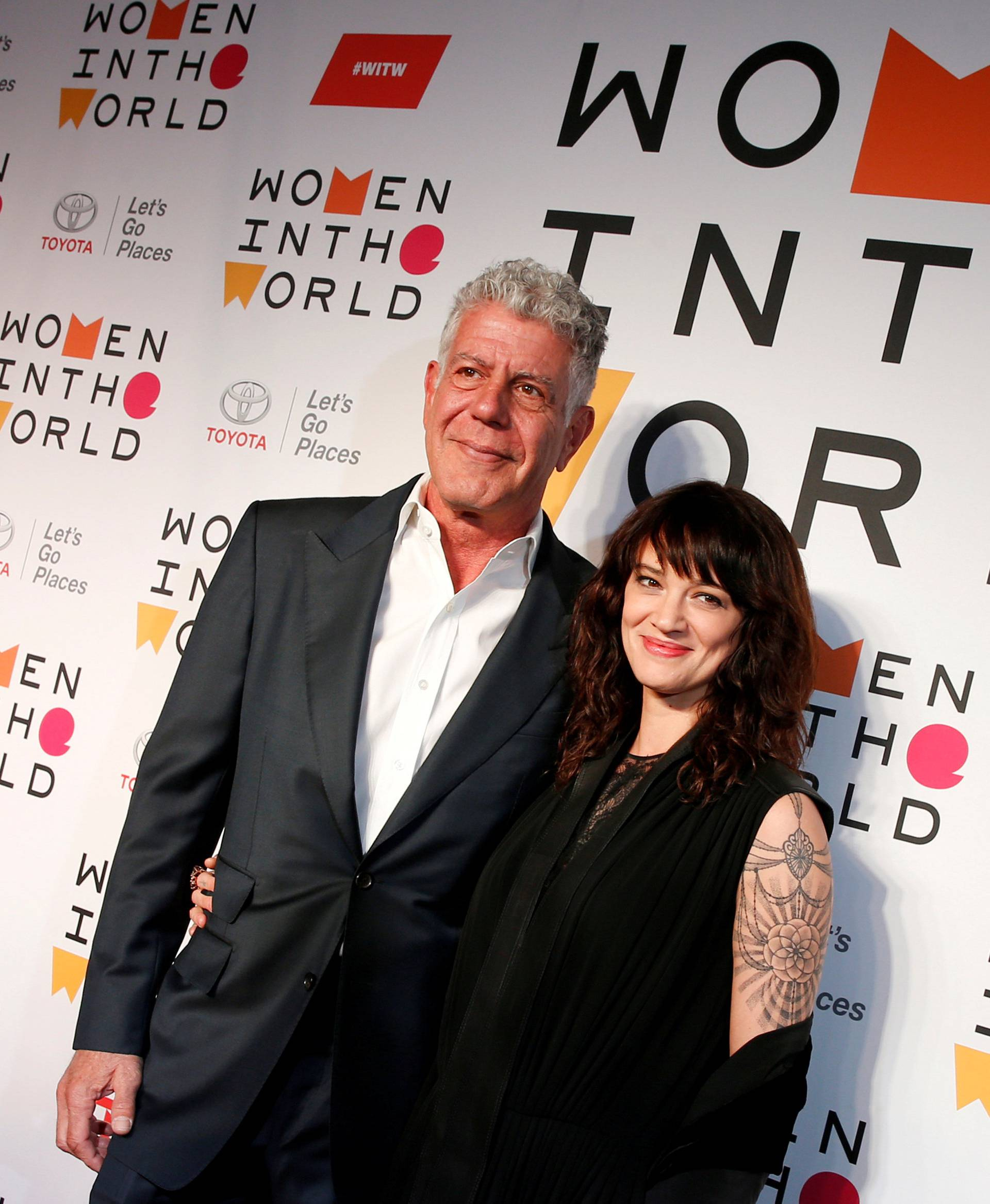FILE PHOTO: Anthony Bourdain poses with Italian actor and director Asia Argento for the Women In The World Summit in New York