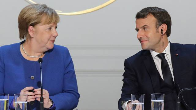 FILE PHOTO: German Chancellor Angela Merkel and French President Emmanuel Macron give a news conference after a meeting in Paris