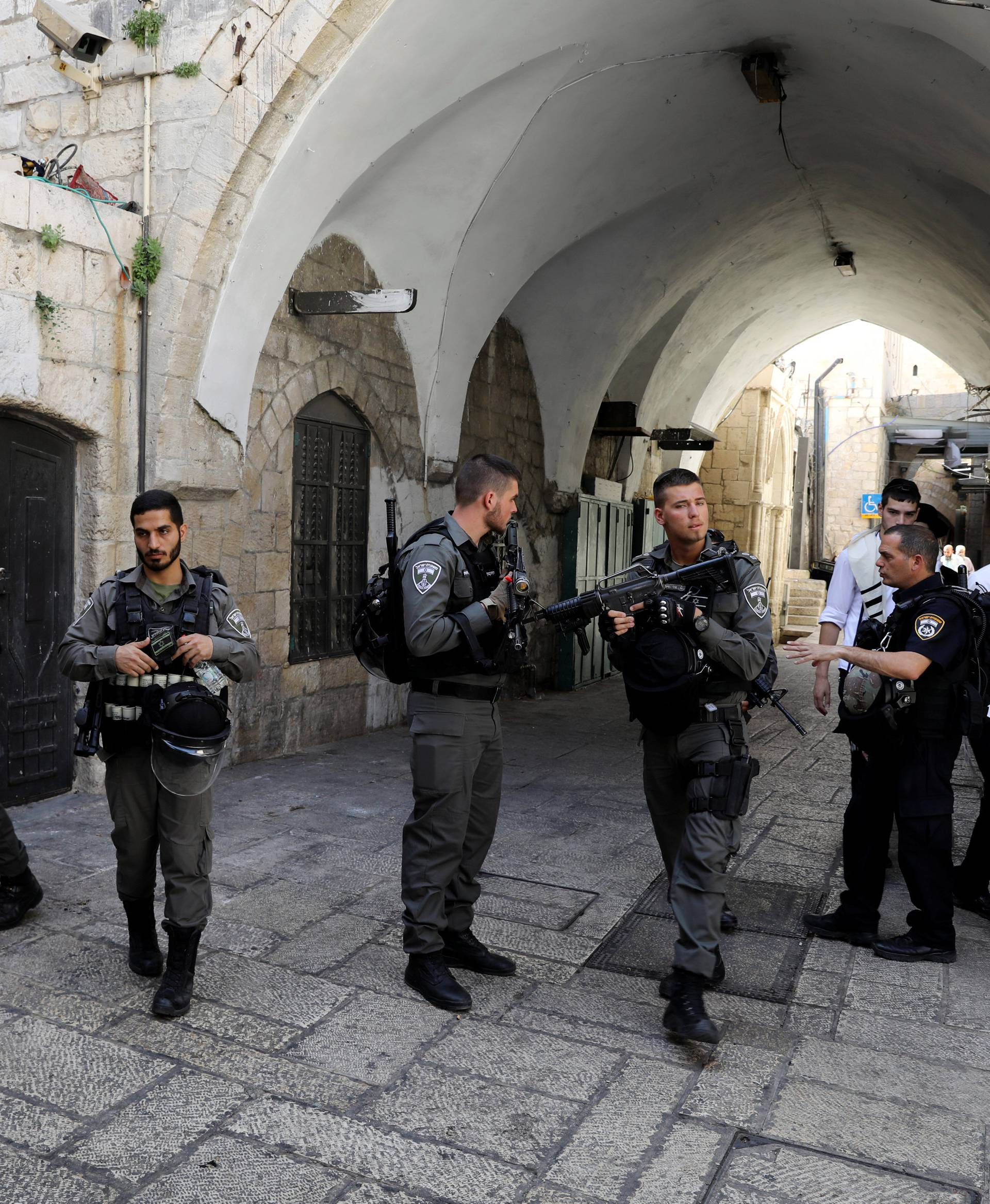 Israeli border policemen secure the area near the scene of the shooting attack, in Jerusalem's Old City