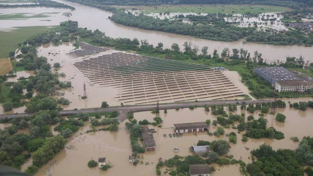 An aerial view shows flooded solar pawer plant outside of Ivano-Frankivsk