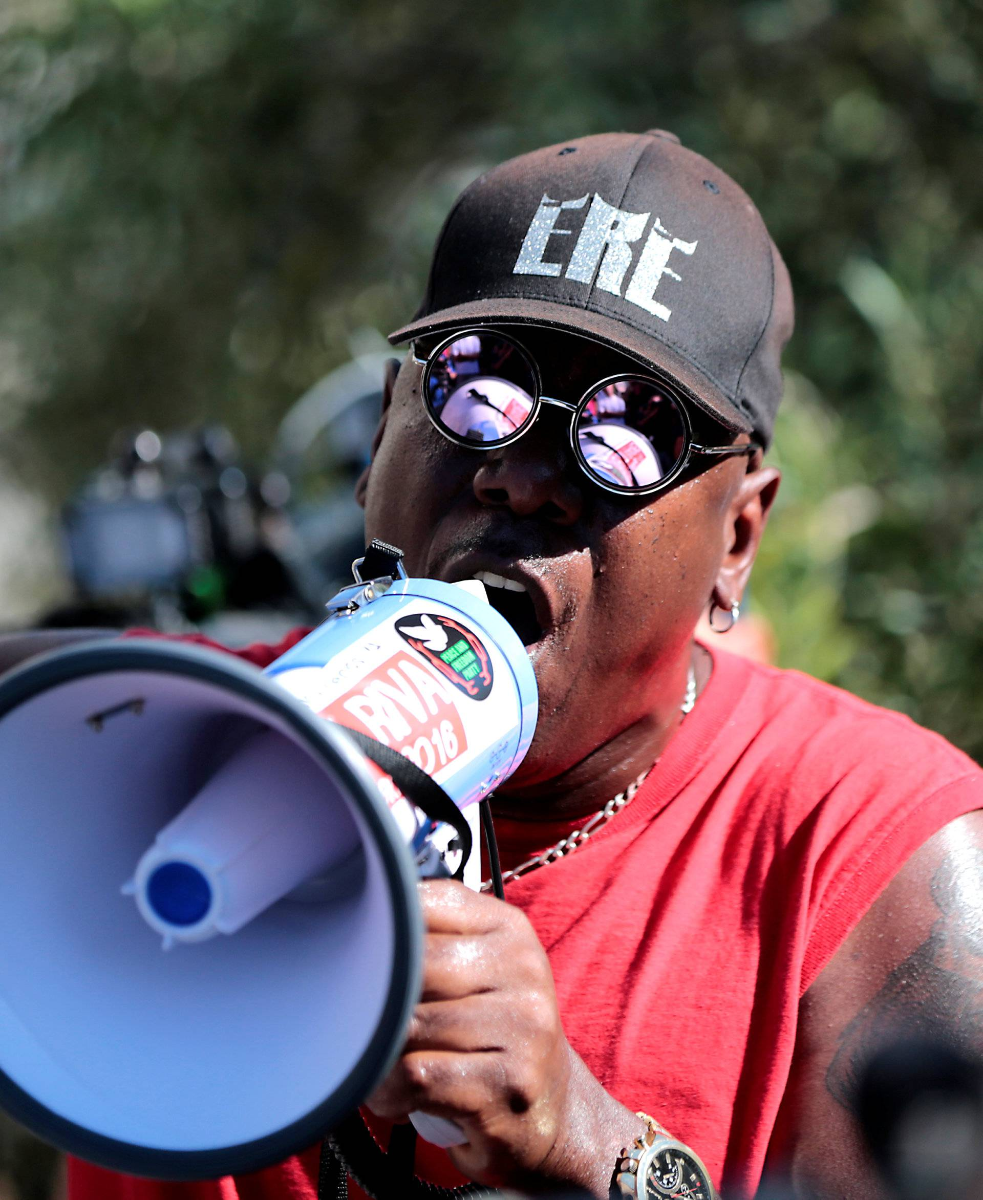 Protesters gather at the El Cajon Police Department headquarters to protest fatal shooting of an unarmed black man Tuesday by officers in El Cajon, California