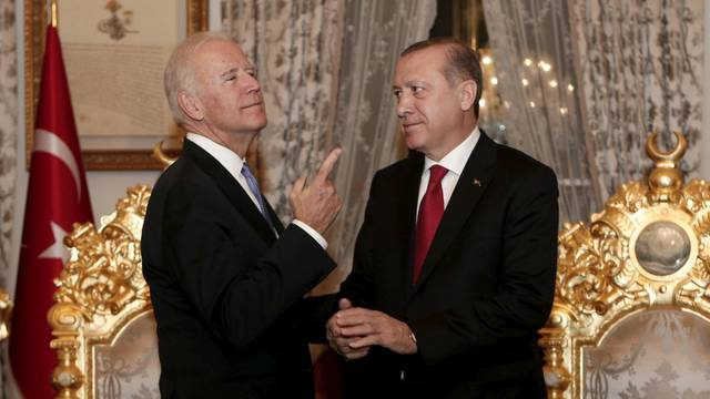 FILE PHOTO: Turkish President Tayyip Erdogan and U.S. Vice President chat after their meeting in Istanbul, Turkey