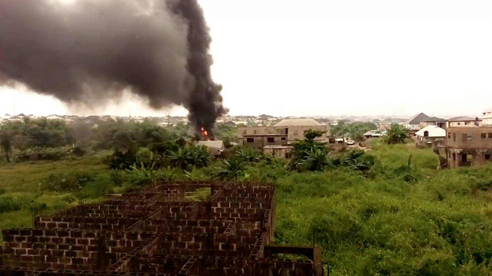 Smoke fills the air following a pipeline explosion in the residential area of Iyana Odo, Isheri-Olofin, Lagos