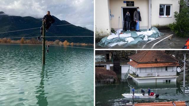 'Ženo, jači sam od poplave': Hrabri radnici penjali se na 11 metara da selu spase struju