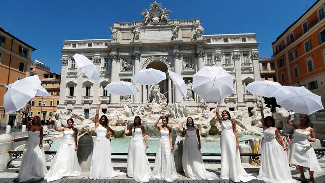 Brides wearing wedding dresses hold a flash mob near Trevi fountain to protest against the postponement of their weddings due to the coronavirus disease (COVID-19) outbreak in Rome