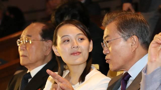 South Korean President Moon Jae-in talks with Kim Yo Jong, the sister of North Korea's leader Kim Jong Un, while watching North Korea's Samjiyon Orchestra's performance in Seoul