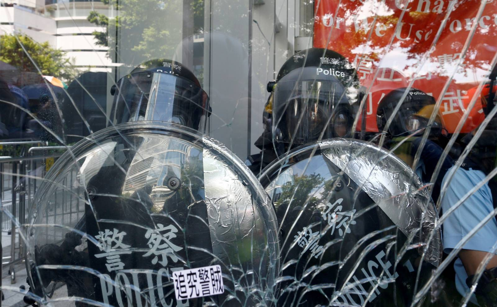 Riot police is seen inside the Legislative Council building where protesters try to break into, during the anniversary of Hong Kong's handover to China in Hong Kong