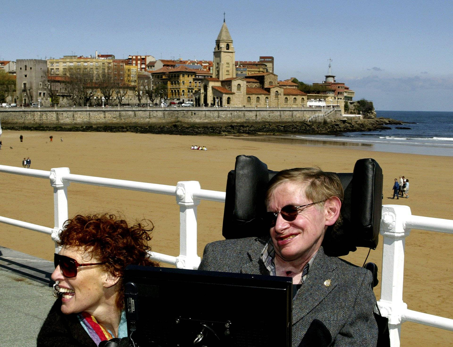 FILE PHOTO: British astrophysicist Hawking and his wife Elaine pose in front of a beach in Spain.