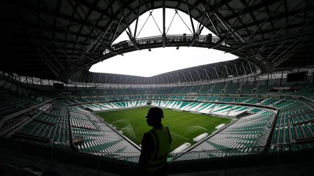 A worker is seen inside the Education City Stadium built for the upcoming 2022 FIFA World Cup soccer championship during a stadium tour in Doha
