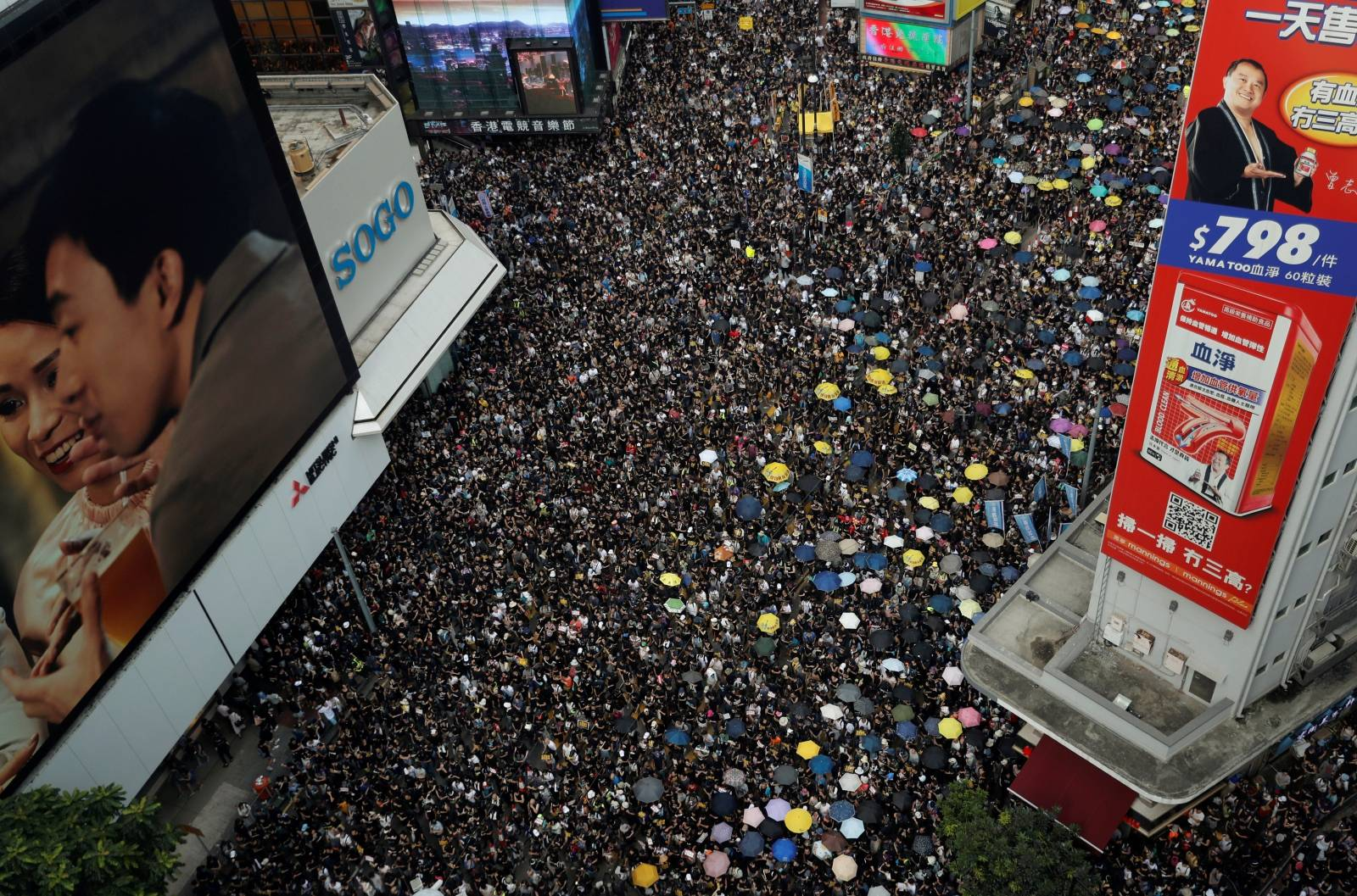 Anti-extradition demonstrators march to call for democratic reforms, in Hong Kong