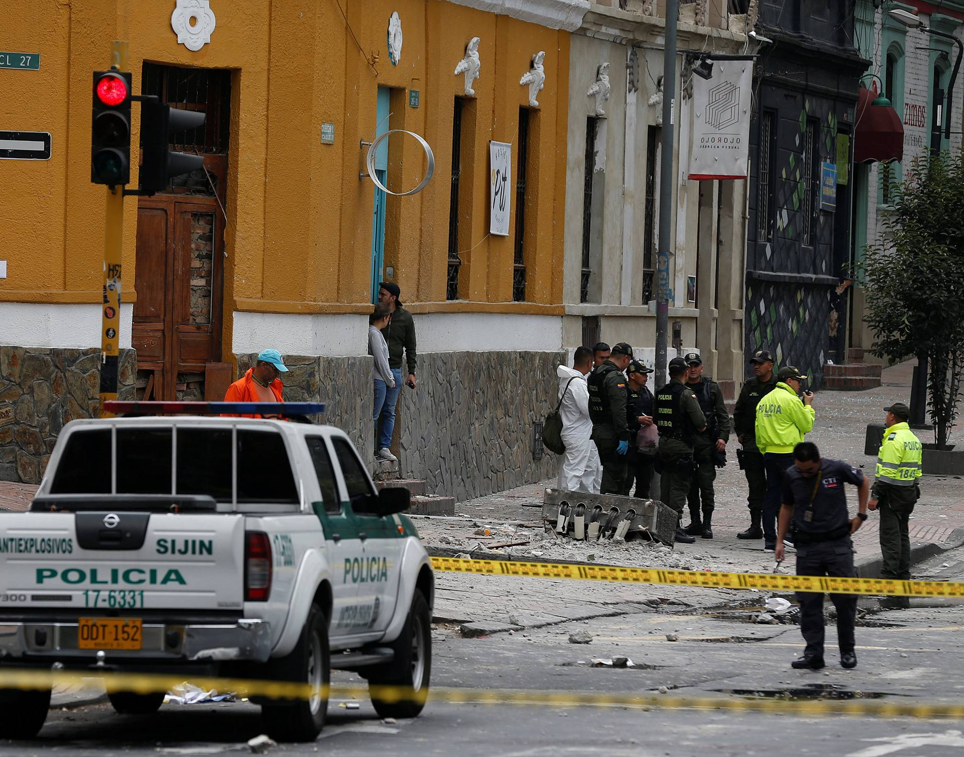 Police work the scene where an explosion occurred near Bogota's bullring
