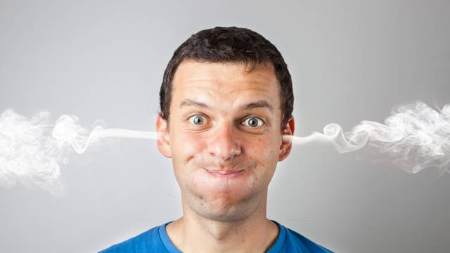 Stress and anger, angry upset man with head pressure and smoke coming out from his head