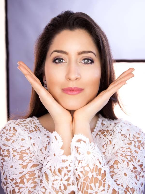 Beautiful young woman doing face yoga