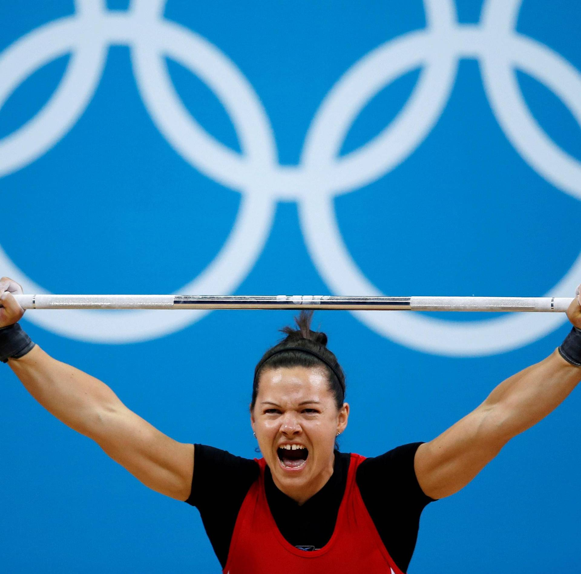 FILE PHOTO: Canada's Christine Girard competes on the women's 63Kg weightlifting competition at the ExCel venue at the  London 2012 Olympic Games