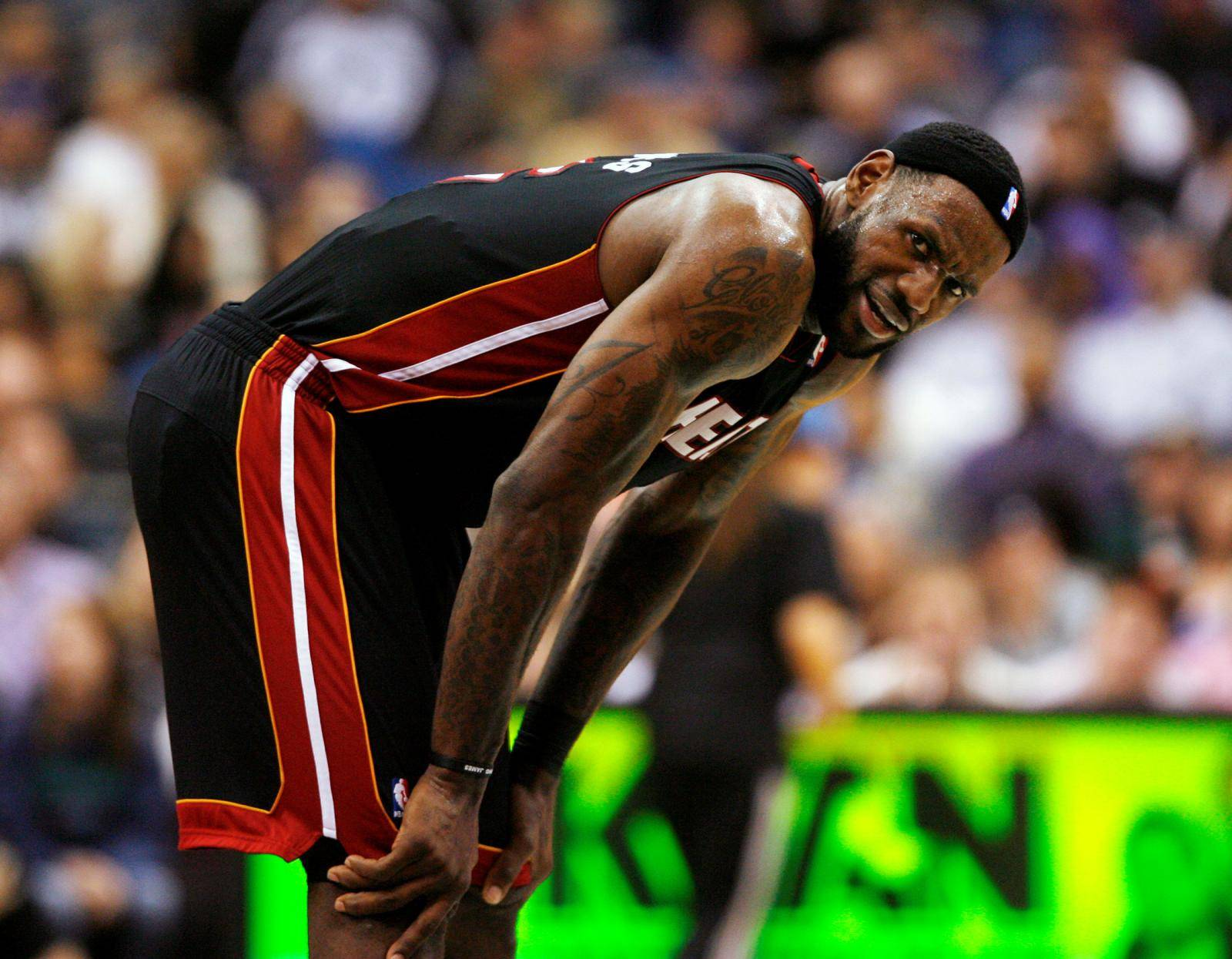 FILE PHOTO: Miami Heat forward LeBron James stands at midcourt during his side's 111-92 victory against the Minnesota Timberwolves at the Target Center in Minneapolis, Minnesota.