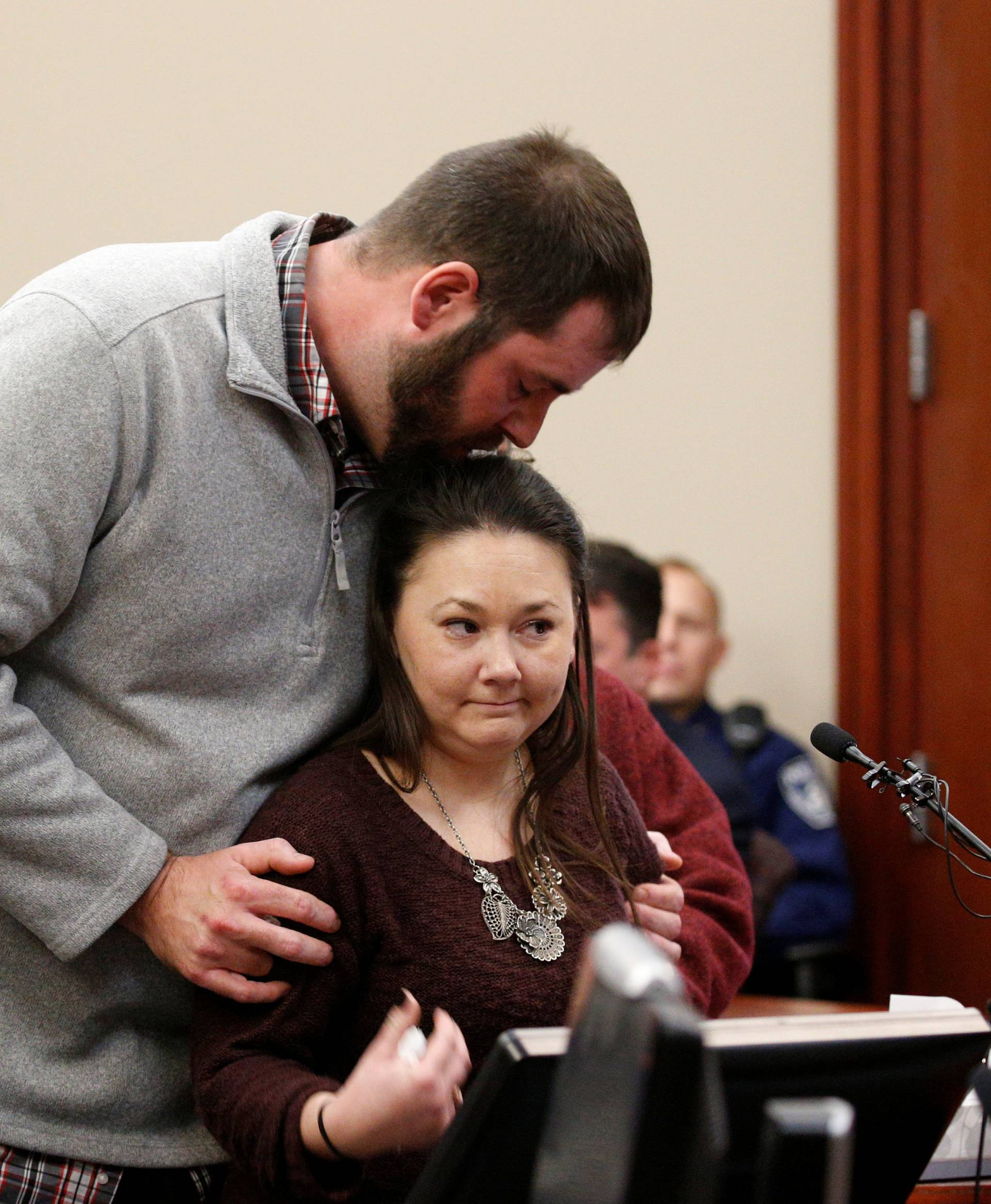 Victim Anya Gillengerten is comforted by her boyfriend as she speaks at the sentencing hearing for Larry Nassar, a former team USA Gymnastics doctor who pleaded guilty in November 2017 to sexual assault charges, in Lansing, Michigan
