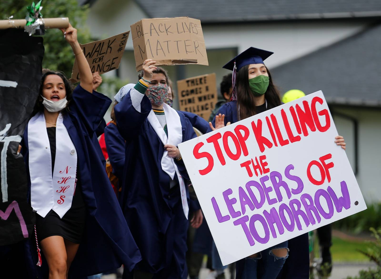 Nathan Hale High School seniors join with others to protest against racial inequality in the aftermath of the death in Minneapolis police custody of George Floyd on their graduation day in Seattle
