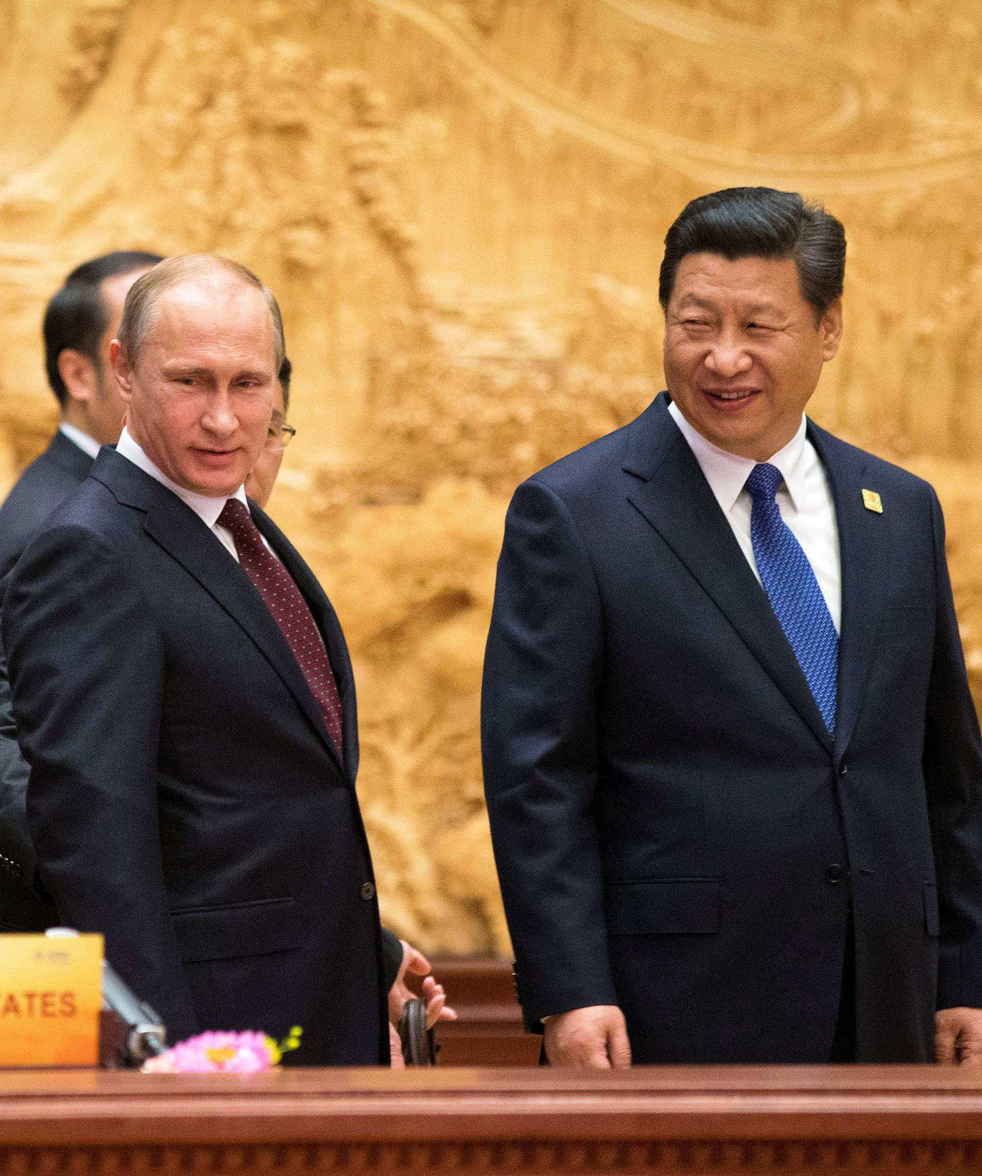 U.S. President Obama, arrives with Chinese and Russian counterparts, Xi and Putin, at the the APEC Summit plenary session in Beijing