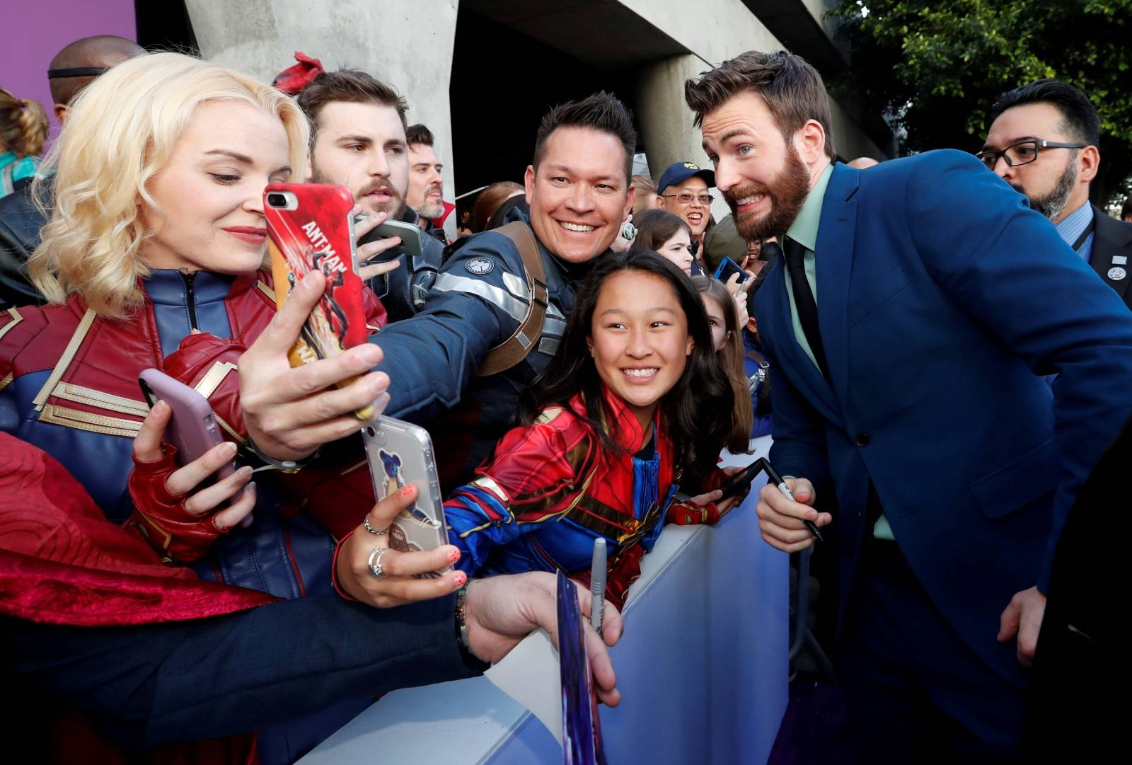 """Cast member Chris Evans poses with fans on the red carpet at the world premiere of the film """"The Avengers: Endgame"""" in Los Angeles"""