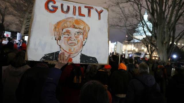 A small group of protesters gather at the U.S. Capitol following the Senate's votes to acquit Trump at the conclusion of his impeachment trial in Washington