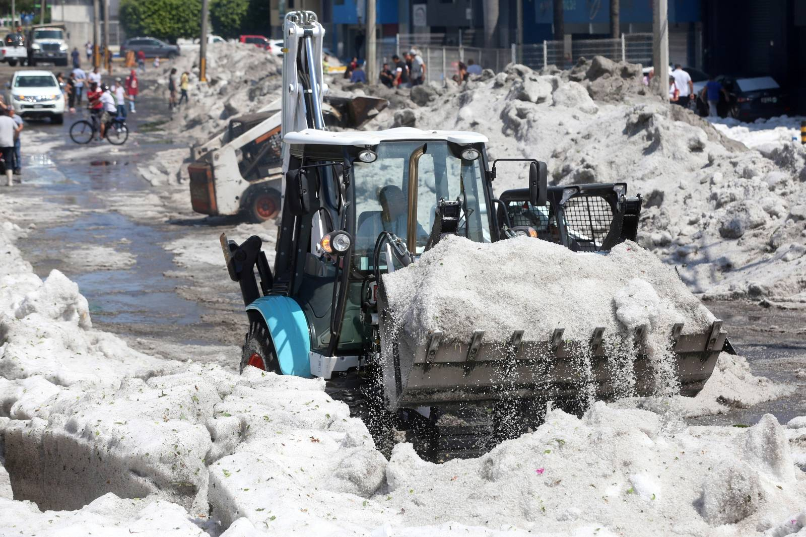 A truck carries ice as it cleans the street after a heavy storm of rain and hail which affected some areas of the city in Guadalajara,