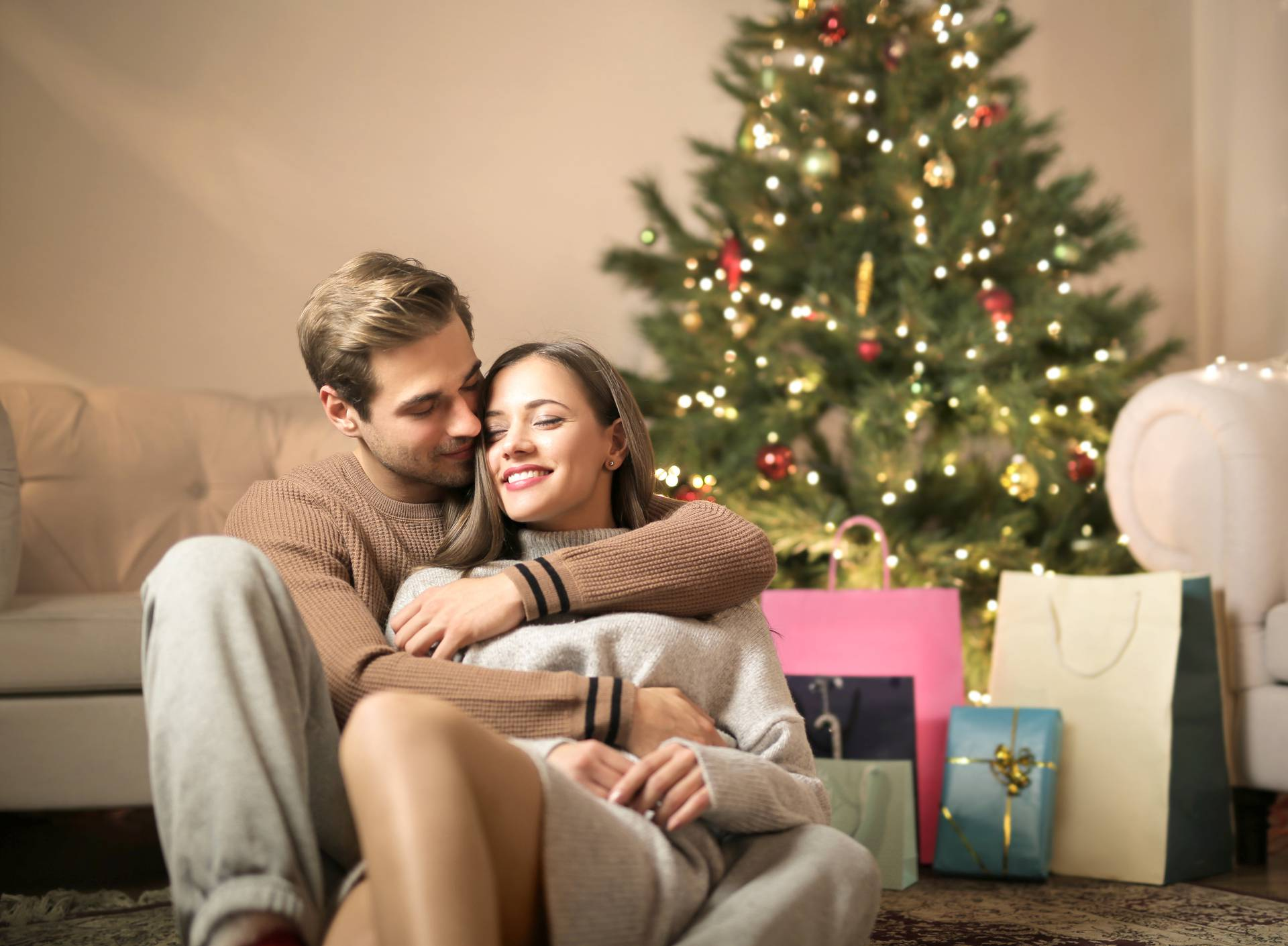 Lovely couple cuddling and kissing in the living room