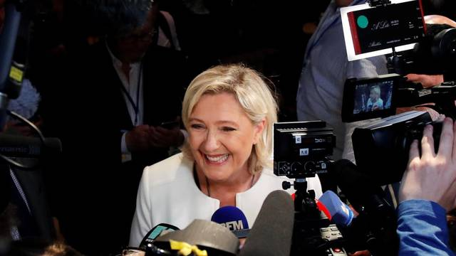 French far-right National Rally (Rassemblement National) party leader Marine Le Pen talks to the media after the first results in Paris