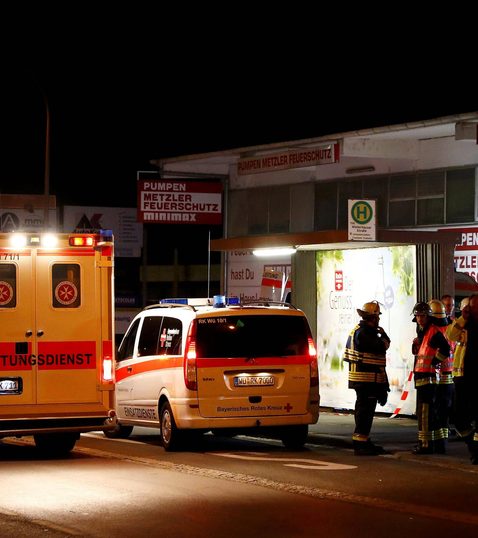 German emergency services workers work in the area where a man with an axe attacked passengers on a train near Wuerzburg