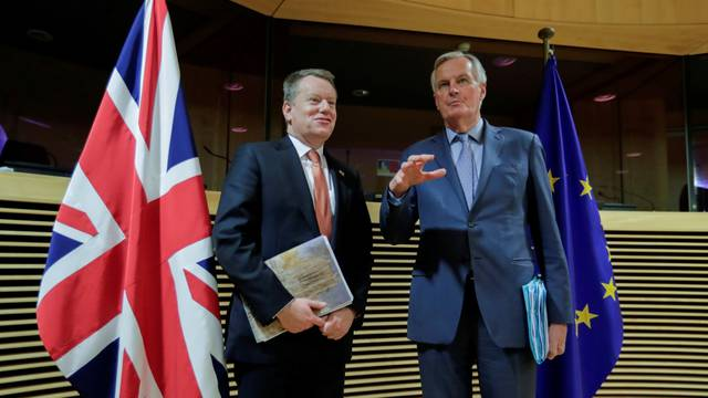 FILE PHOTO: European Union chief Brexit negotiator Michel Barnier and British Prime Minister's Europe adviser David Frost 5 are seen at start of the first round of post -Brexit trade deal talks