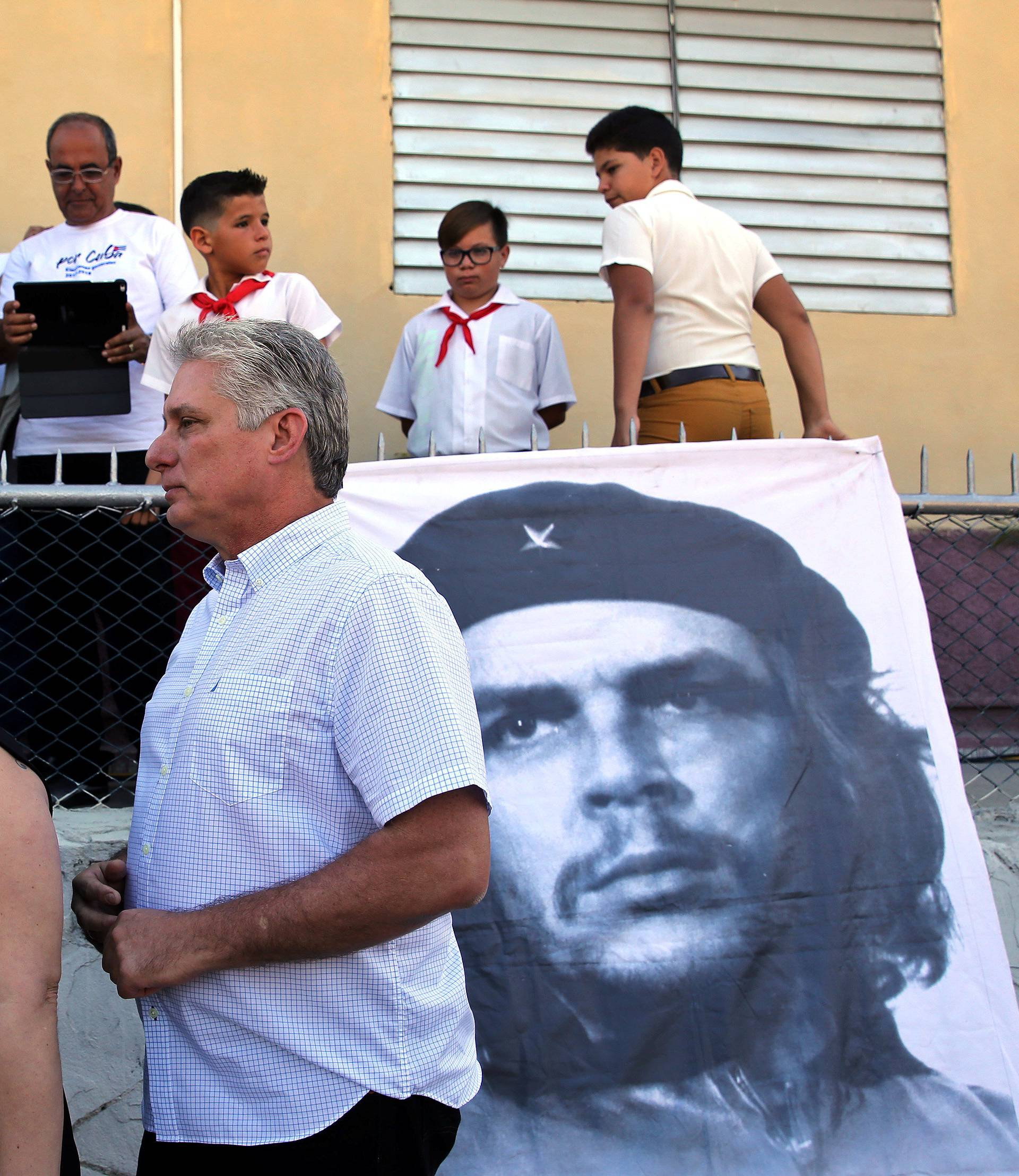 FILE PHOTO: Cuba's First Vice-President Miguel Diaz-Canel and his wife Lis Cuesta stand in line before Diaz-Canel casts his vote during an election of candidates for the national and provincial assemblies, in Santa Clara
