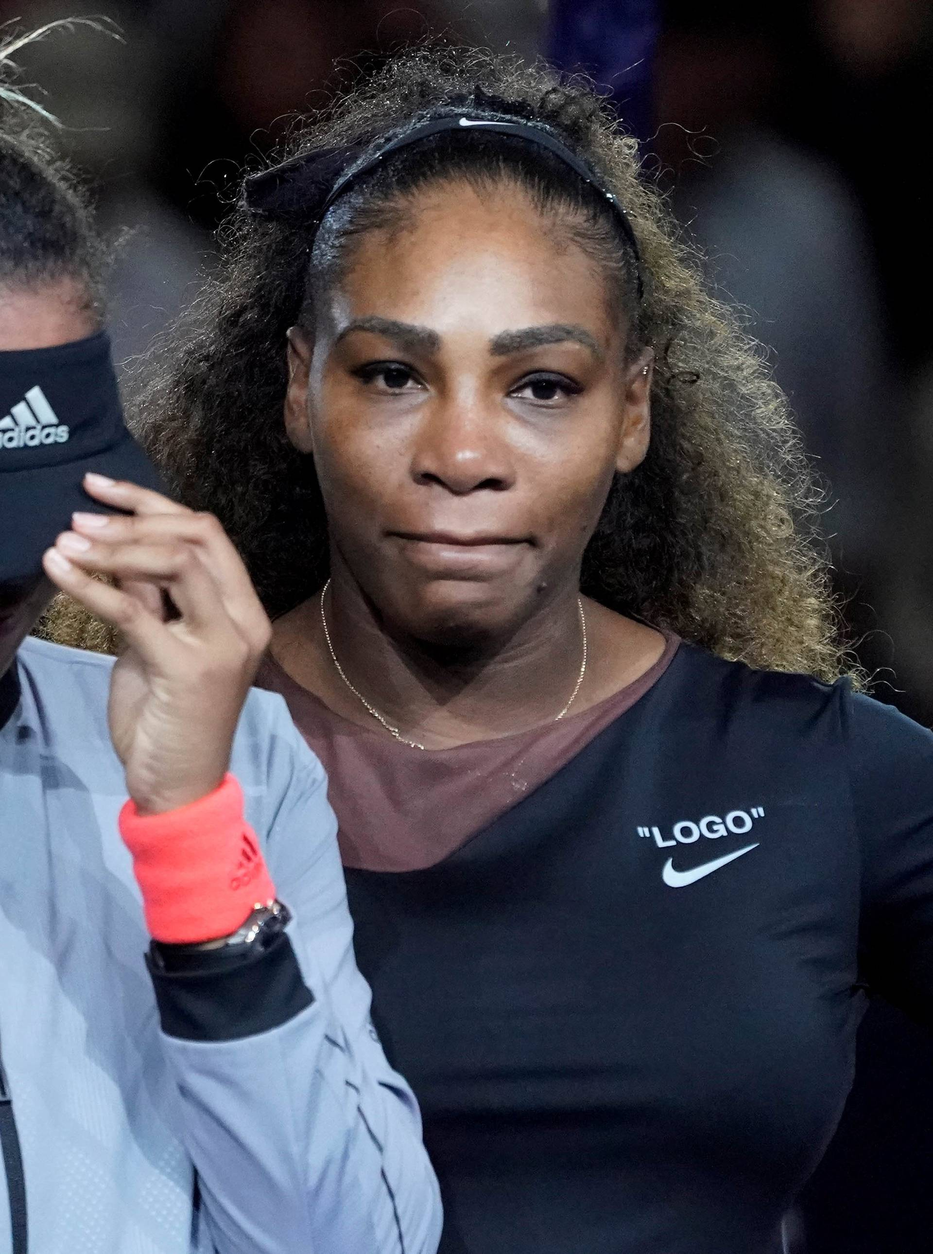 FILE PHOTO: Naomi Osaka of Japan cries as Serena Williams of the USA comforts her in New York