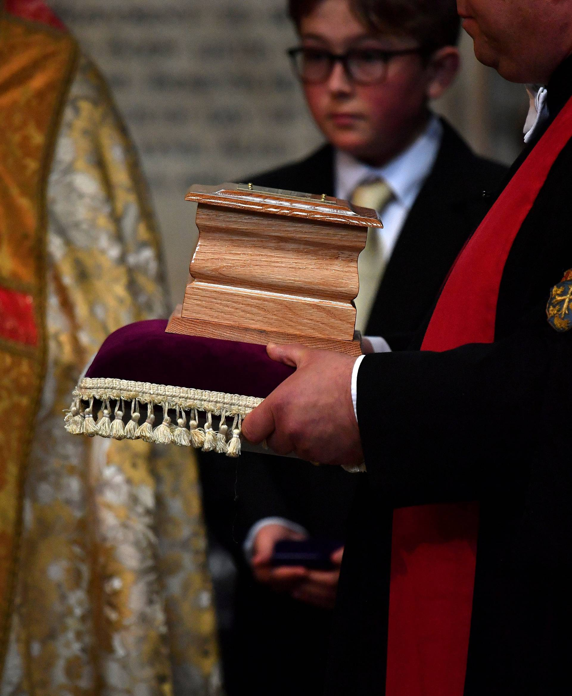 The ashes of British scientist Stephen Hawking are held at the site of interment in the nave of the Abbey church, during a memorial service at Westminster Abbey, in London