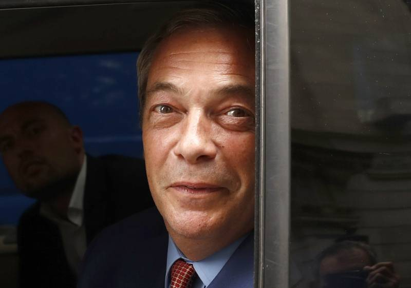 Nigel Farage, the leader of the United Kingdom Independence Party looks out of a car window as he leaves following the EU referendum vote, in central London