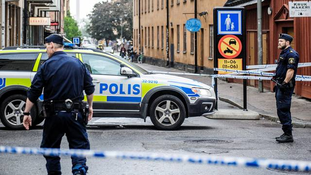 Truck driver is on the run after crashing into taxi, in the Sodermalm district, in Stockholm