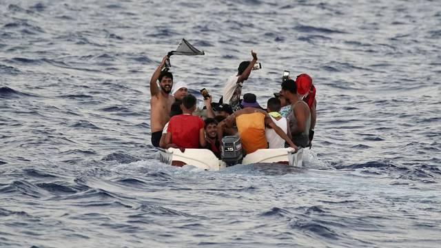 Migrants navigate to the Italian island of Lampedusa