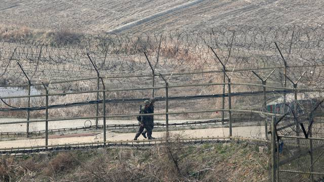 Paju, South Korea. 1st April 2014. South Korean soldiers patrol along the military fences near DMZ, Paju, South Korea, on Tuesday April 1, 2014. North and South Koreas exchanged artillery fire across the western maritime border, the Northern Limit Line (N