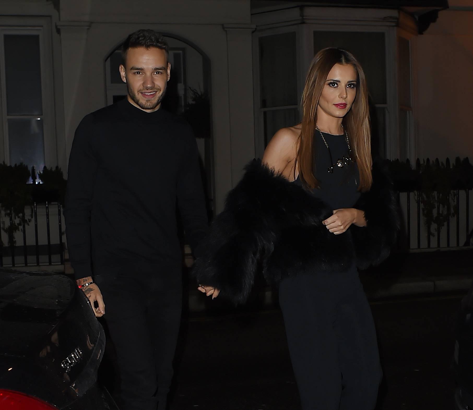 Cheryl Fernandez- Versini and Liam Payne hold hands on date night.