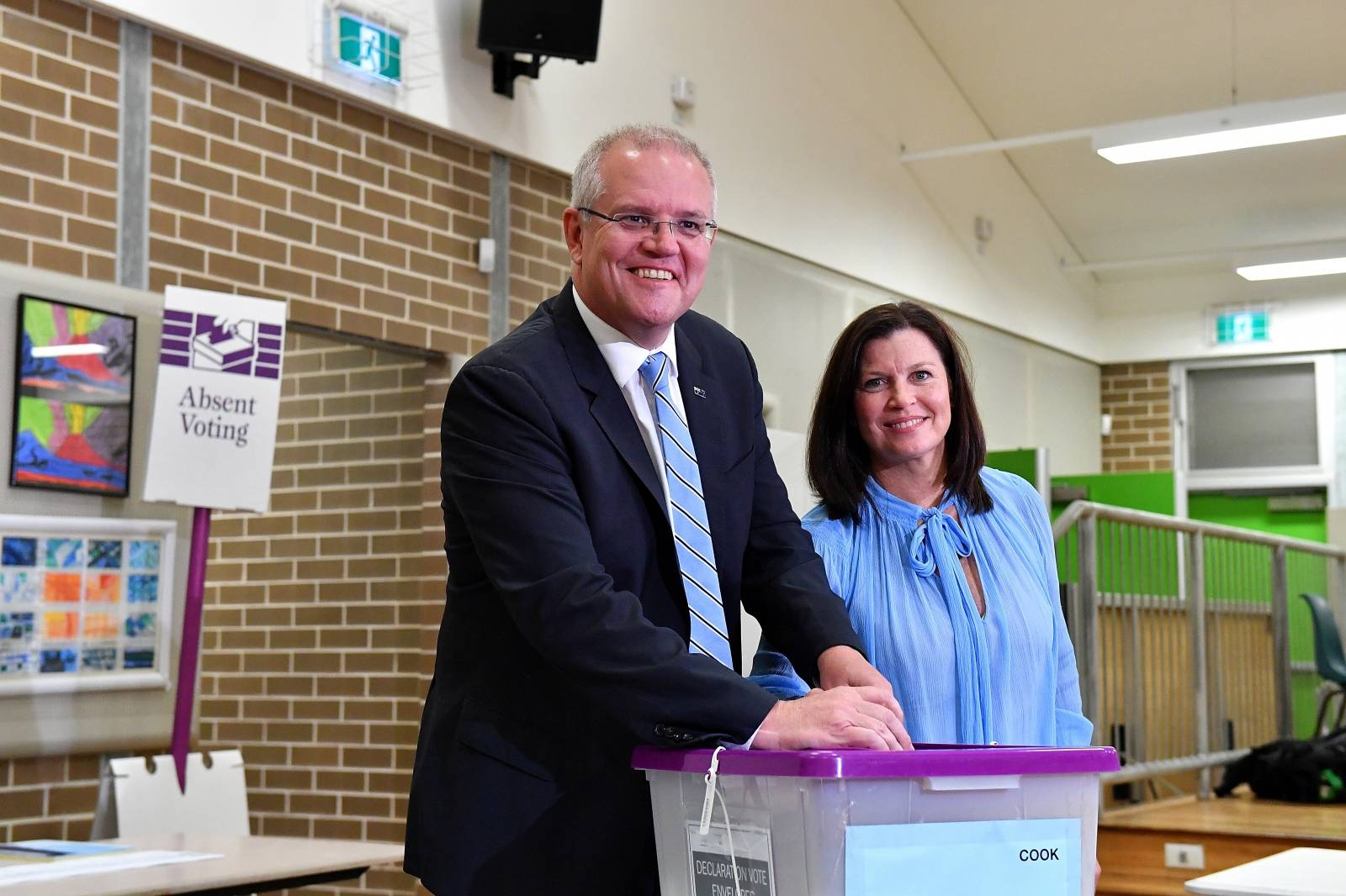 Australian Prime Minister Scott Morrison casts his vote alongside wife Jenny, on Election day, at Lilli Pilli Public School, in Sydney