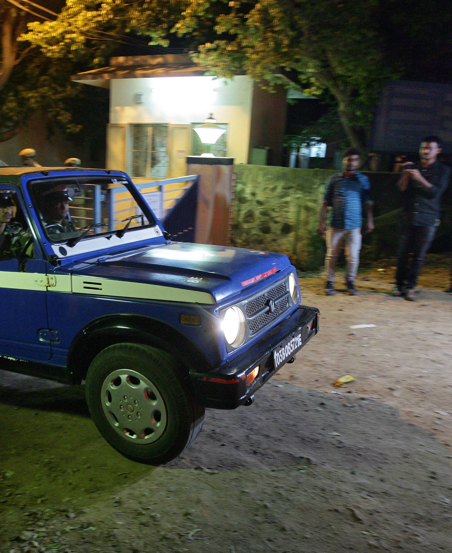 An Indian Air Force vehicle leaves the house of a pilot who was captured by Pakistan, in the southern city of Chennai