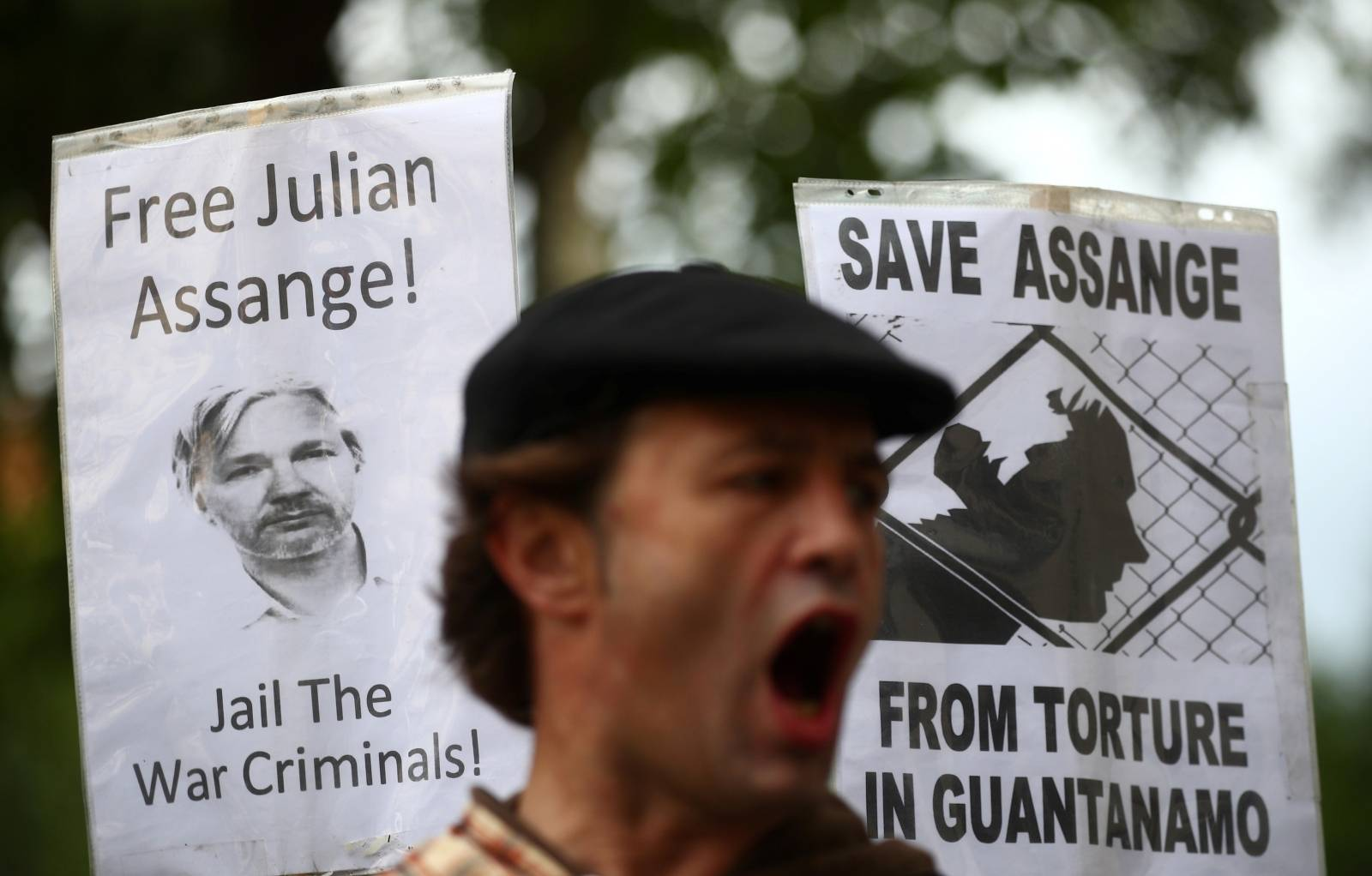 A demonstrator protests outside of Westminster Magistrates Court, where a case hearing for U.S. extradition of Wikileaks founder Julian Assange is held, in London