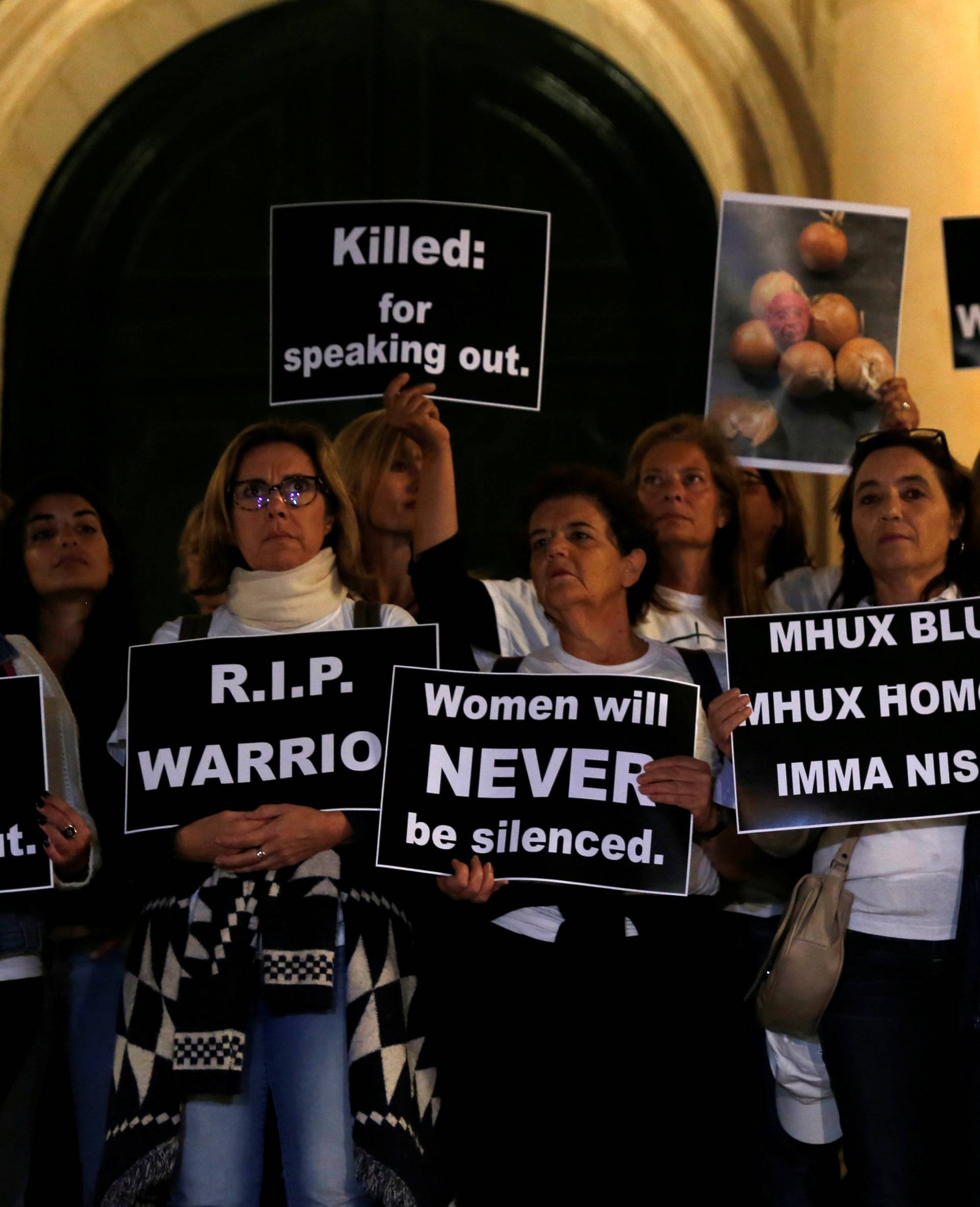 Protestors stand outside the Auberge de Castille, the office of Prime Minister Muscat, at the start of a four-day protest against the assassination of investigative journalist Daphne Caruana Galizia, in Valletta